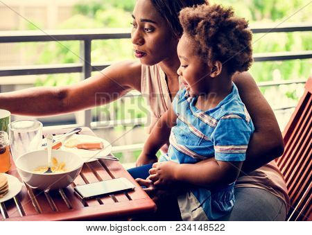 Single mom having breakfast with her child