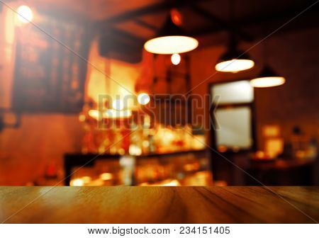 Top Of Wood Table With Blur Lamp Light Party At Bar Or Pub In The Dark Night Background