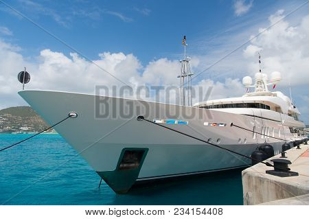 Yacht Moored In Philipsburg, Sint Maarten. Ship On Sea Pier On Cloudy Blue Sky. Luxury Travel On Yac