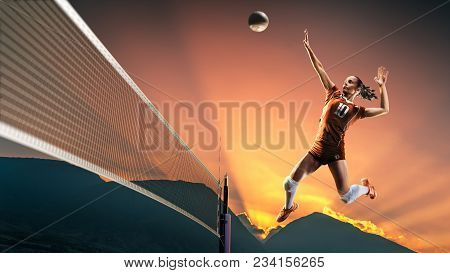 Professional Female Volleyball Player In Action On The Court