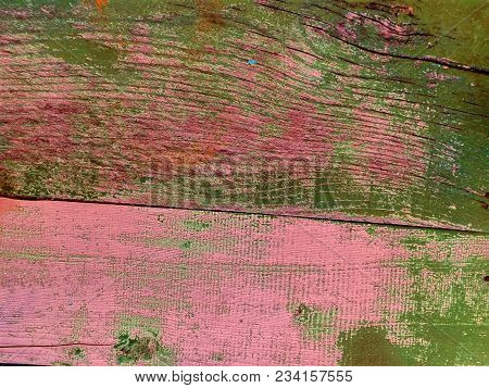 Green-pink Wooden Fence Background. Close-up Wall Or Floor Wooden Green Pink Plank Panel Or Board As