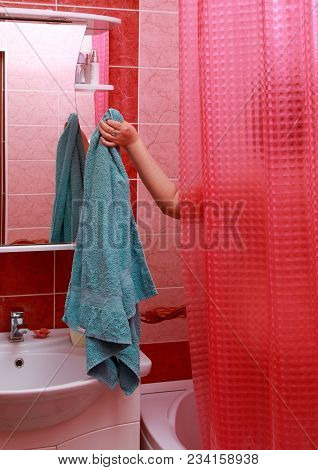 The Girl Took A Shower And Takes A Towel From Behind The Curtain.
