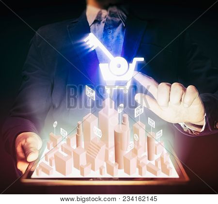 Man Holds A Tablet Pc In His Hands. Tablet Pc Has A Hologram With Real Estate For Sale. Concept Of O