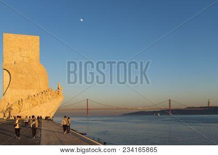 Lisbon, Portugal - January 10, 2017: Tourists Enjoying The Sunset Near The Monument To The Discoveri