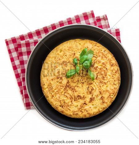 Spanish Potato Omelet (tortilla De Patatas) Isolated On White Background In A Frying Pan, Top View
