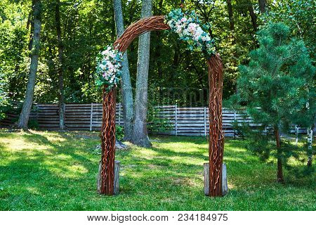 Beautiful Wedding Arch With Pink And White Flowers And Greenery Prepared For Wedding Ceremony In Gar