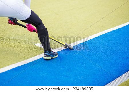 Field Hockey Female Player Performing Shot With Stick