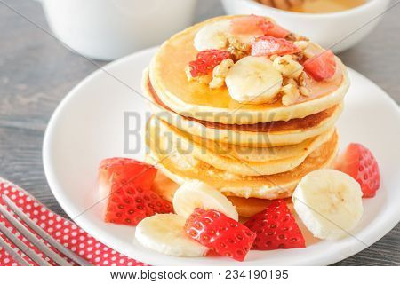 Homemade breakfast with pancakes and fruits