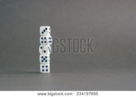 Stack Of Gaming Dice With Copy Space On Gray Background. Concept For Games, Game Board, Role Playing