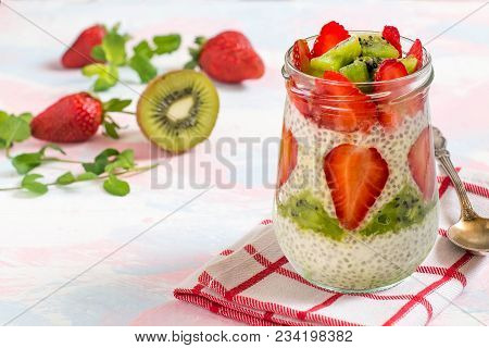 Chia Pudding With Yoghurt, Honey, Strawberry And Kiwi On Pastel Colorful Background. Cleansing, Diet