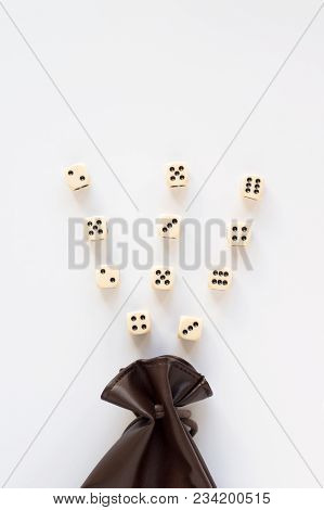 Set Of Gaming Dice Rolled Out Of Leather Bag On White Background. Concept With Copy Space For Games,