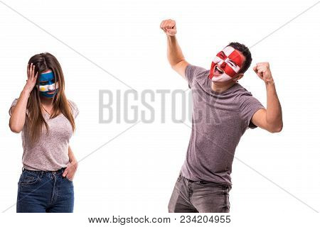 Happy Football Fan Of Croatia Celebrate Win Over Upset Football Fan Of Argentina With Painted Face I