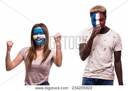 Happy Football Fan Of Argentina Celebrate Win Over Upset Football Fan Of France With Painted Face Is