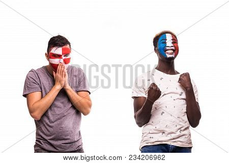 Happy Football Fan Of France Celebrate Win Over Upset Football Fan Of Croatia With Painted Face Isol