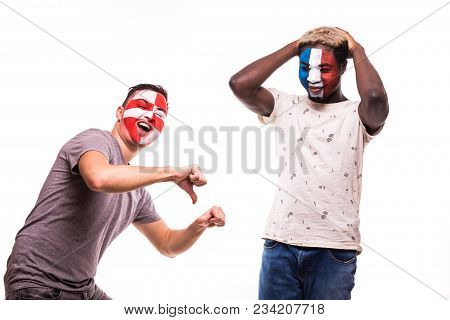Happy Football Fan Of Croatia Celebrate Win Over Upset Football Fan Of France With Painted Face Isol