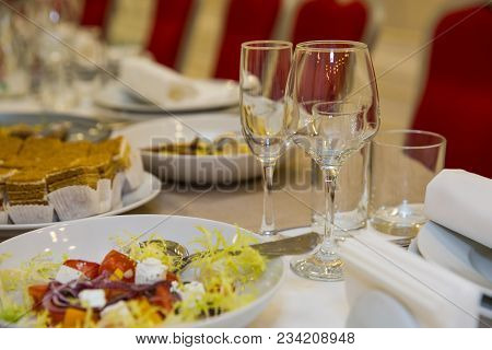 Empty Glasses Of Champagne And Wine With Tasty Snacks On The Banquet Table At The Buffet Or Banquet