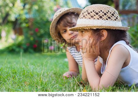 Sisters, Two Little Girls On The Grass, Summertime, Holidays From School