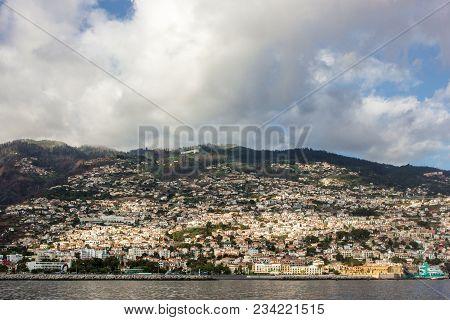 Beautiful Sea Coast In Madeira Island, Portugal.city Harbor On Sea Coast Under Dramatic Sky. Funchal