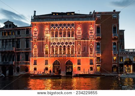 Beautiful Illuminated Building On Grand Canal At Dusk, Venice, Italy. Night Illumination Of Medieval
