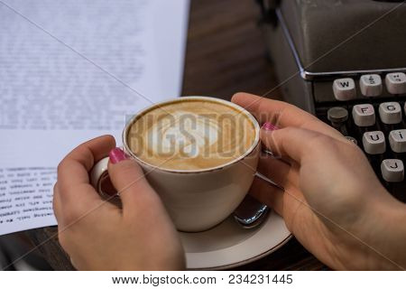 Writer Concept. Female Hands Holding A Cup Of Cappuccino