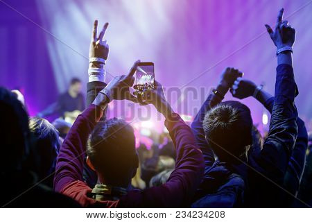Hand With A Smartphone On Live Music Concert, Taking Photo Of Stage, Live, Music Festival.