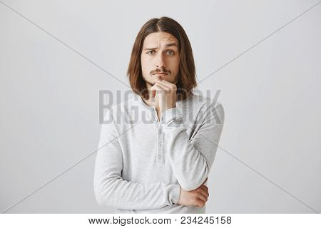 You Made Me Interested And Curious, Tell Details. Portrait Of Handsome Young Male With Beard And Lon