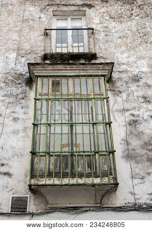 Window In Dirty Mold Covered House In Arcos De La Frontera Near Cadiz In Spain