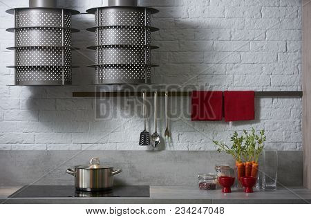 Modern White Kitchen Interior Design. Luxury Kitchen With The Counter And Induction Cooker Stove Und