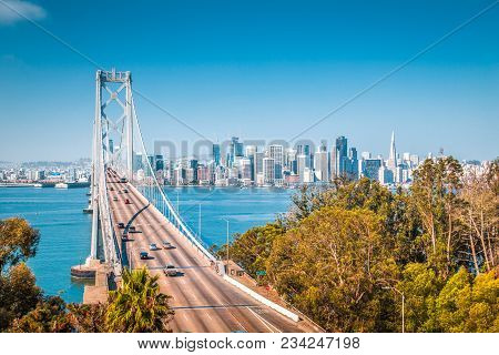 Classic Panoramic View Of San Francisco Skyline With Famous Oakland Bay Bridge Illuminated On A Beau
