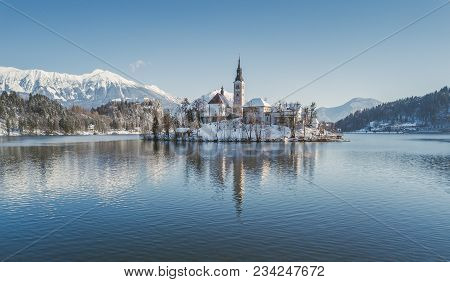 Panoramic Aerial View Of Famous Bled Island (blejski Otok) At Scenic Lake Bled With Bled Castle (ble