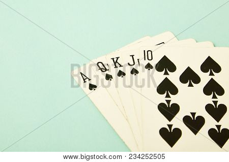 Royal Straight Flush Playing Cards Poker Hand In Spades Blue Pastel Background