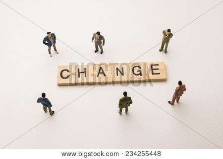 Miniature Figures Businessman : Meeting On Change Word By Wooden Block Word On White Paper Backgroun