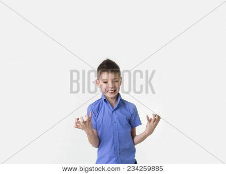 The Studio Shot Of A Handsome Young Teen Boy Winning Over White Background. Happy Teenager With Eyes