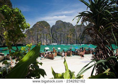 KO PHI PHI LEH, THAILAND, February 1, 2014: Overcrowded beach of Maya Bay, Andaman Sea, famous tourist destination in the Ko Phi Phi achipelago