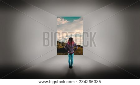 Young Girl Standing In A Room With A Door Opened Leading To A Beautiful Landscape. The Concept Of Es