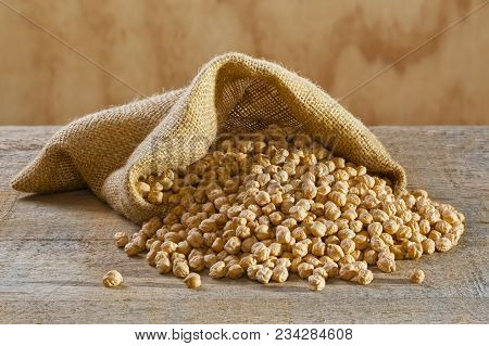 Chickpeas In Burlap Sack - Raw Chickpeas Spilling From A Burlap Or Jute Sack.