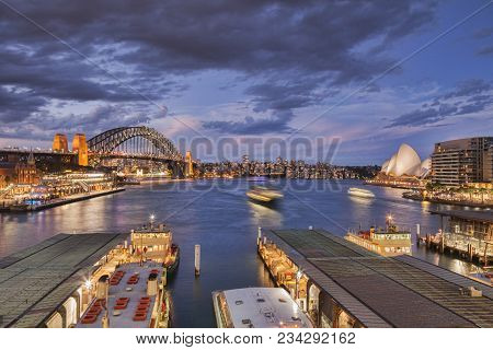12 March 2014: Sydney, Australia - Busy Sydney Harbour, Illuminated At Twilight, Some Boats With Mot
