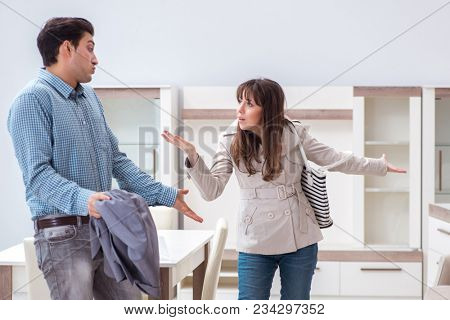 Young couple disappointed with price in furniture store poster