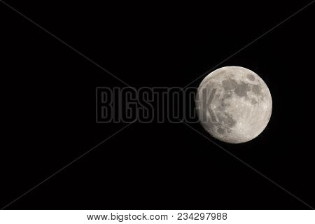 Waxing Gibbous Moon, Landscape Orientated Image With Moon Isolated On Black Background With Text Or