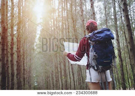 Hipster Tourist Hold And Look Map On Trip, Lifestyle Concept Adventure, Traveler With Backpack On Ba