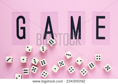 Gaming Dice With Word Game On Pink Background. Concept For Games, Game Board, Presentation, Banners