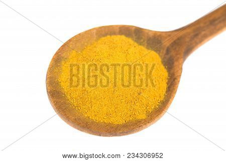 Turmenic,curcuma Powder  On Wooden Spoon  Isolated On White Background