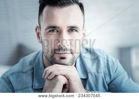 Positive Smile. Nice Delighted Handsome Man Smiling And Looking At You While Being In A Good Mood