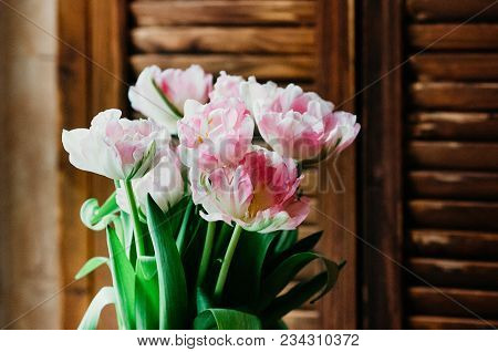 A Soft Focused Bouquet Of Pink Flowers, Wooden Jalousie In The Background, Rustic Style, Closeup Vie