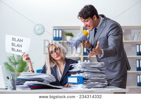 Angry boss yelling at his assistant secretary