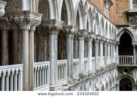 Venice, Italy - May 20, 2017: Colonnade Of The Doge`s Palace Courtyard. Doge`s Palace Or Palazzo Duc