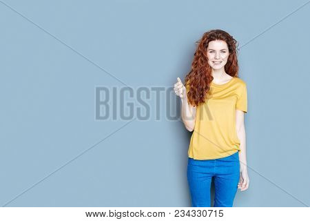 Positive Emotions. Nice Cheerful Delighted Woman Smiling And Expressing Her Positive Emotions While