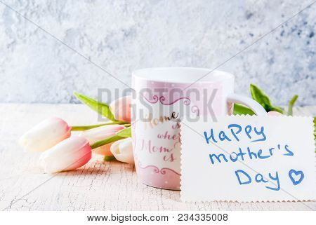 Mother's Day Concept, Greeting Card Background. Flowers Tulips On A Light Concrete Table, Mug With I
