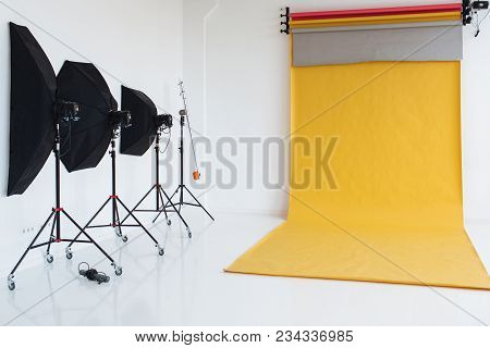 Empty Studio With Lighting Equipment And Colourful Backgrounds. Nobody Indoor. Professionatl Devices