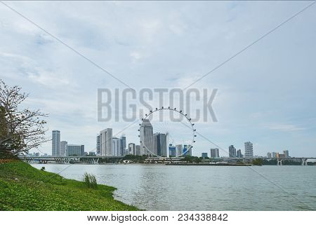 Singapore - Jan 19, 2016: Beautiful Scenic View Of Blue Sky, River And Observation Wheel